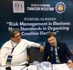 Election Commissioner Luie Tito F. Guia receiving explanation from Sead Alihodzic about incremental and comprehensive approaches towards institutionalization of ERM during a break [Photo: Adhy Aman/International IDEA]