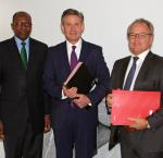 From left:H.E. Dr. Kaire Munionganda Mbuende, Ambassador of the Republic of Namibia to the Kingdoms of Belgium and the Netherlands, the Grand Duchy of Luxembourg, and Mission to the European Union; Andrew Bradley,Director of the Office of International IDEA to the European Union;Carl Michiels, Chairman of the Management Committee of the BTCat a signing ceremony between the BTC and International IDEA on 4 OCtober 2017